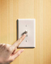 Image of finger switching lightswitch