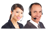 Two customer service agents with headsets are smiling