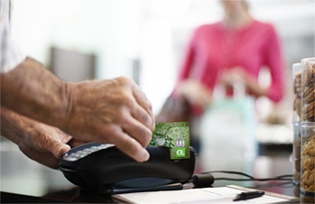 A merchant swiping a TD Credit Card