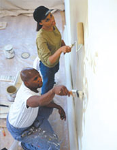 Image of a couple painting their home