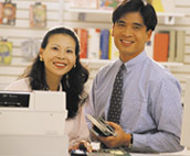 Image of couple by cash register