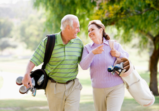 Middle-age couple enjoying a nice afternoon round of golf.